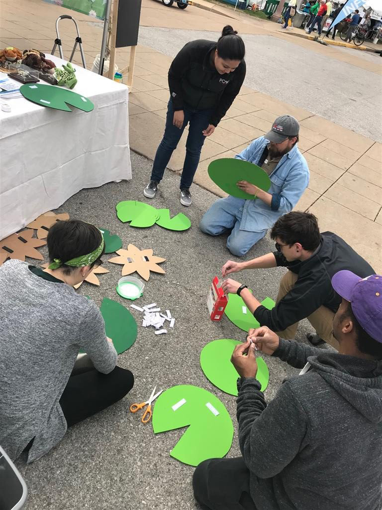 Jess, Jayvn, Architectural Designers Kayleen Lindstrom and Teague Peak, and Michael Dawson of the Saint Louis Zoo prep lily pads to decorate the booth